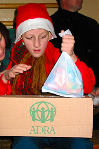 Orphan girl receives ADRA Christmas gifts