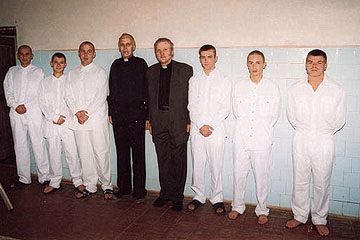 Pastor Andrejs Arinsh and chaplain Rihards Krievinsh among baptism candidates in Jelgava prison