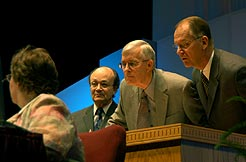 From left: Angel Rodriquez, director of the Biblical Research Institute; William Johnsson, editor of the Adventist Review; and Mike Ryan, director of Global Mission check the exact wording of the proposed protocols for revising the Adventist statements of fundamental beliefs, before answering a question from a delegate.