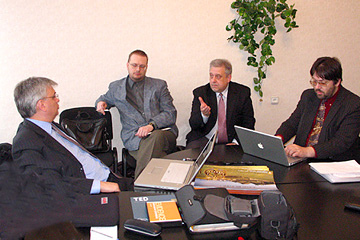 Leaders of the evangelism for postmoderns concept LIFEdevelopment (LD) discuss implementation strategy. Riga, Latvia. 2006.04.05
