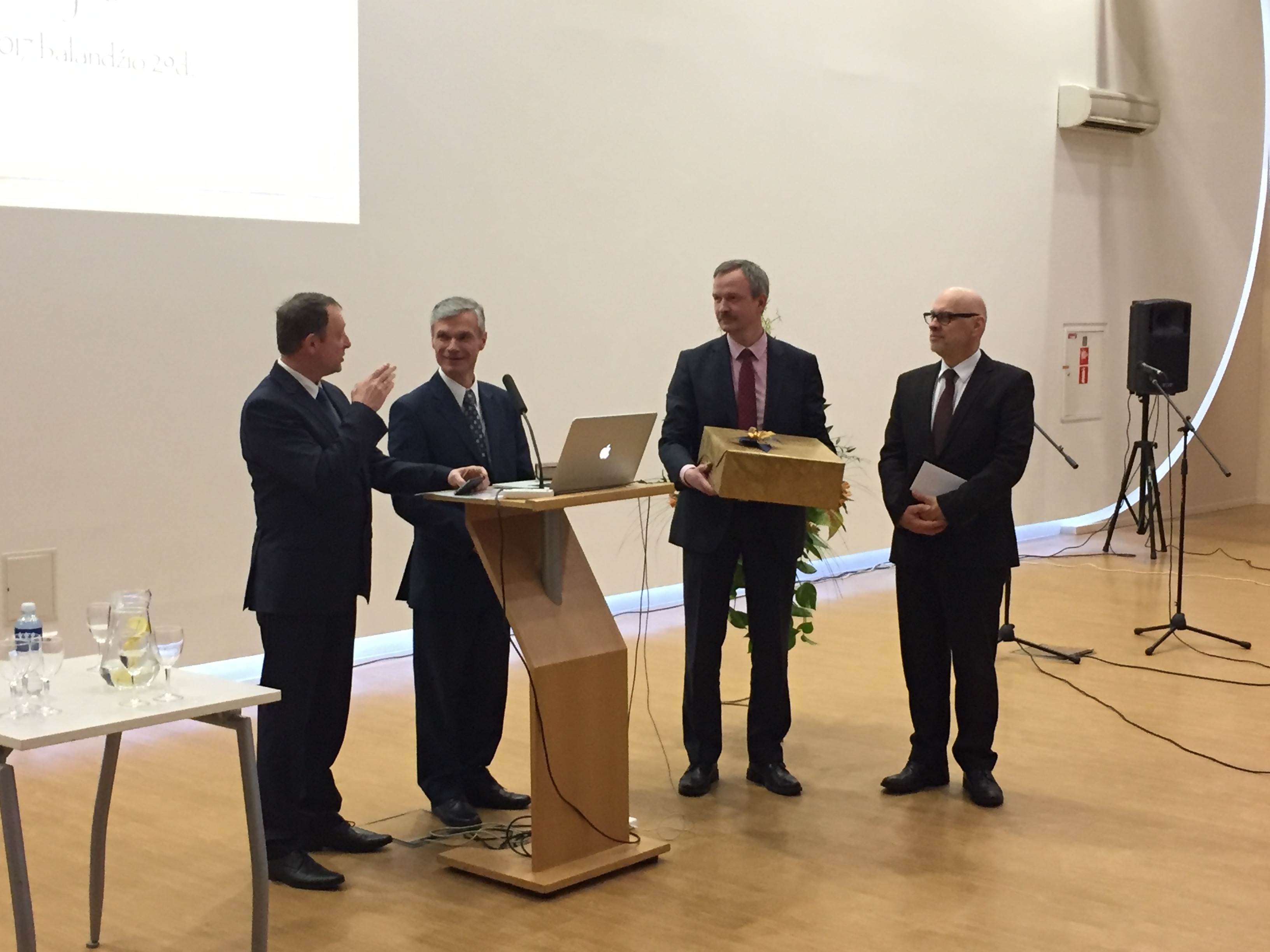 David Nõmmik (left) presents a gift on behalf of the Baltic Union and Estonian and Latvian Conferences